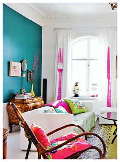 dark teal wall and bright colors.