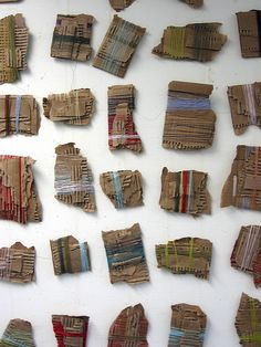Thread & Cardboard Installation  (This would look cool as a gallery wall... frame and mat each piece seperately & hang side by side over an entry or hall table or from floor to ceiling, etc..)