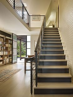 Inspiring Home Interior with Plenty of Bookcases Inside: Minimalist Modern Style Homes Staircase With The Iron Fences And Grey Footing Near ...