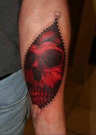 Sick ripped flesh skull tattoo..