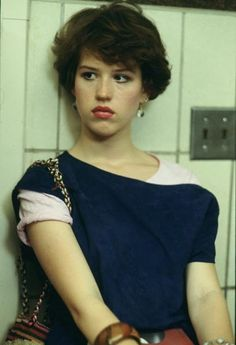 Molly Ringwald was a big idol of this era. The movies she was in were huge hits and girls were dressing like her. Dressing like someone was a form of flattery and people being like their favorite celebrities was important to them.
