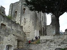 CHATEAU DE MONTRICHARD, France: was captured by local warlord Hughes I d'Amboise in 1109. He enlarged the castle to the size we see today. The castle was dismantled for Henri IV in order to limit the power of regional warlords, leaving the ruin of today, from which visitors have a good view of the Cher Valley.