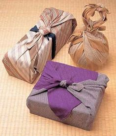 Furoshiki Wrapping (Wrap gifts w/ reusable fabric instead of paper)