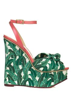 A wedge sandal cool enough to wear at your Palm Beach summerhouse while sipping mojitos and counting your diamonds. By Charlotte Olympia.