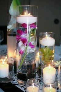 fuschia orchids in water with candles-Great centerpiece idea!