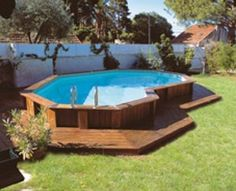 Wooden deck around above ground pool