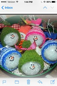 Use clear ornaments, fill with fake snow.  Make face with Sharpie pen, and use baby sock for the hat. babi sock, craft, snowman ornaments, snowmen ornament, baby socks, fake snow, clear ornament, glass ornaments, hat