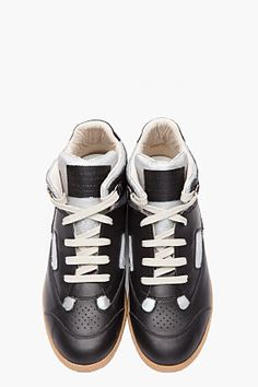 MAISON MARTIN MARGIELA Black and silver hand-painted Mid-Top Sneakers  $740.00