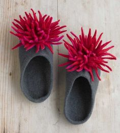 Hand-felted wool slippers with red chrysanthemums handmade from luxurious wool by a group of women in Kathmandu. Richly colored with natural dyes and durably constructed, these comfortable slippers quickly mold to the contours of your feet. $65 from VivaTerra catalog