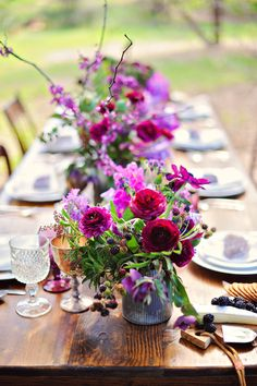 purple tablescape, photo by Arina B Photography http://ruffledblog.com/purple-inspired-wedding-ideas #flowers #centerpieces #floralrunner