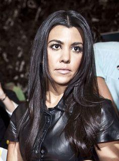 Kourtney Kardashians straight and sleek hairstyle