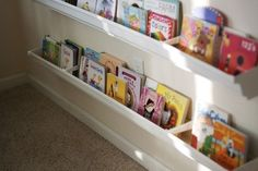 I put gutters up over Alyssa's window and closet to hold all the small stuffed animals she just couldn't part with. Great storage idea for books too!