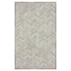 Handcrafted cowhide rug with a chevron motif.  Very similar to the one I have in our house--it takes a beating and still looks great!