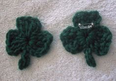 SHAMROCK     Materials and supplies:    Crochet hook size J  Small amount green worsted weight yarn  Pin back  Hot glue and hot glue gun            Pin:    Chain 3, join with a slip stitch in first chain to form a ring.    Petal (make 3): Chain 3, trc, dc, trc, ch 3, slip stitch in ring.    Stem: Chain 4, sc in 2nd chain from hook, and slipstitch in remaining two chains. Fasten off.    Weave in ends.    Lay right side down on heat proof surface. Hot glue pin back to petal opposite the stem.