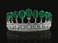 This emerald and diamond tiara that once belonged to Princess Katharina Henckel von Donnersmarck sold for 12.3 million dollars - The diamond-and-emerald confection was commissioned by German prince Guido Henckel von Donnersmarck for his second wife Katharina around 1900, and is believed to have belonged to Eugenie, wife of French Emperor Napoleon III.   It has a row of 11 polished pear-shaped emeralds, totaling 500 carats, and was purchased by an anonymous bidder.