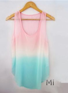 Tie Dye Tank Top - Want to convey a soft feminine look? Pair this top with white or ivory camisole, some lacey shorts or soft pastel colored bottoms along with a long delicate necklace. Maybe even add a soft floral headband or clip to finish the look.