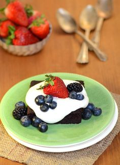 Gluten-free fudge cake with coconut cream and berries ~ refined sugar and dairy-free, too!