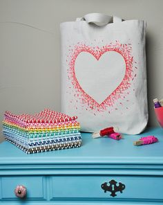 Living with Punks: Tutorial: Negative Space Heart Bag I LOVE this!  The possibilities are endless!  Bags, towels, shirts, blank fabric to be sewn into stuff...  Wow!  Super easy and cute!