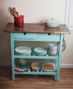 Ikea DIY hack. Forhoja kitchen cart stained walnut and painted a bright turquoise color. There are hooks on both sides for hanging various utensils. Great for spaces with little storage.