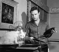 Brando and friend listening to records