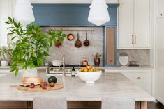 Creative use of color, gorgeous countertops and backsplash. Bolderwood Renovation — Whittney Parkinson Design