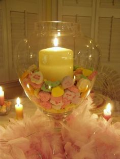Cute and inexpensive Valentine's day decor...candy heart, candle and a pink feather boa.