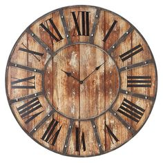 Weathered wood wall clock with Roman numerals and metal overlay detail.    Product: Wall clock    Construction Material: