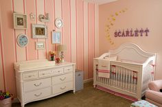 This pink striped wall adds such a feminine touch to this #babygirl #nursery
