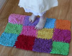 another rug from tees! i love these. now to get a loom! @Terri :o) what about for your little? from all the pot holders she was making!.http://petitepurls.com/Spring10/spring2010_apatchwork.html