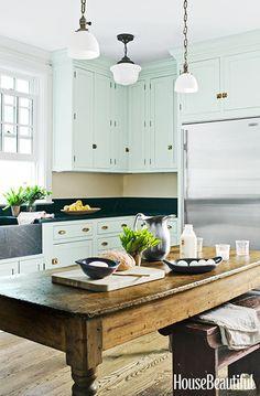 Throwback Decor Trends We Still Secretly Love// mint kitchen cabinet, wood island, stone farm sink, country kitchen