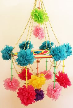 """Traditionally """"Pajaki"""" are made by Polish women in rural villages as decorations for their homes. The materials used to make it include: colored tissue paper, gold colored beads, colored plastic straws, colored yarn, wooden sticks and steel wire"""