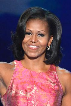 We loved Mrs. Obama's bright smile and shiny, glossy hair. Our First Lady is so fierce!