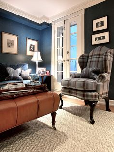 Love the navy and super warm brown. Maybe navy couch + an ottoman in the same color? Or navy couch with a throw in that brown? Maybe paired with two chairs with a medium wood tone and white upholstery?