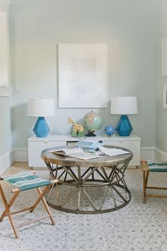 emily-henderson-sunroom | Sherwin Williams sea salt on the walls, bright blue lamps, white console, aged metal table