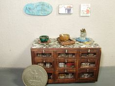 1:24 scale half inch small dollhouse miniature hand crafted hutch with decorative items on top