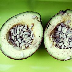 Salty Sunflower Avocado: Craving a salty snack? Skip the oily chips and fill half an avocado with salted sunflower seeds. The creamy texture and slightly sweet flavor of the avocado complements the salty crunch of the sunflower seeds beautifully. This snack is full of healthy fats and is a little over 200 calories #food #drink #recipes