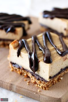 Chocolate Peanut Butter Pretzel Cheesecake Bars have a salty pretzel crust with chocolate peanut butter ganache drizzled over the peanut butter cheesecake. - These look so tempting!