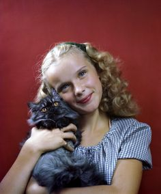 Actress Anne Francis at 14 years old holding a cat, New York City, USA. (Photo by Constance Bannister Corp/Getty Images)