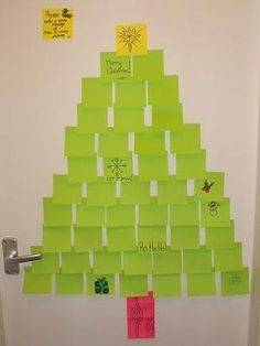 Elf leaves Post It notes in the shape of a Christmas tree