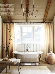 ClawFoot tub. Love ceiling treatment...   Amazing ski chalet bathroom-rustic glam.
