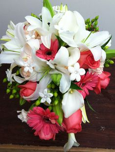 Cascade Bouquet- White lilies, gerbera daisies, roses, calla lilies, hypericum berries  stephanotis | Flickr - Photo Sharing!