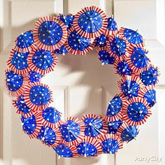 Flag-print paper umbrella wreath - easy & awesome for 4th of July! You can make yours with any cupcake picks, like flags or pinwheels. holiday wreaths, juli 4th, juli parti, juli wreath, paper umbrella, juli idea, patriot wreath, 4th of july, umbrella wreath