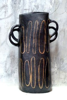 ~Brenda Holzke black stoneware with gold luster