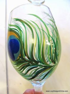 How to Paint on Glass, Hand Painted Peacock Feather Wine Glasses from The Dollar Store DIY.... I'm so going to do this!