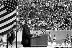 """September 12, 1962 - President John F. Kennedy speaks at Rice University Stadium, Houston, Texas, concerning the nation's efforts in space exploration.  In his speech the President discusses the necessity for the U.S. to become an international leader in space exploration and famously states, """"We choose to go to the Moon in this decade and do the other things, not because they are easy, but because they are hard."""""""