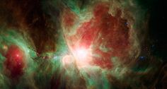 This stunning false-color view spans about 40 light-years across the region, constructed using infrared data from the Spitzer Space Telescop...