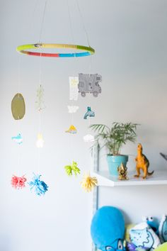 Have kids turn summer vacation memories into a mobile for their room.