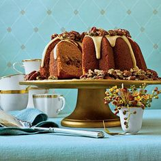 Cranberry-Apple-Pumpkin Bundt | The topping on this bundt—a maple glaze with sugared pecans and pumpkin seeds—will make your guests ooh and ahh. | SouthernLiving.com