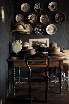 Plates hats, interior, plates, black walls, color, dark walls, textured walls, desk, plate wall
