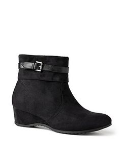 Soft Sueded Bootie: Covered in a soft, faux suede fabric, our wide-width bootie is a step in the right direction for fall. We love it tucked under any of our classic denim styles this season. Ankle cuff. Adjustable buckled ankle strap. Zip opening on side. Wedge heel.  Wide width sizes with stretchable calves. catherines.com #catherines #plussizefashion #fallstyle #widewidthboot #booties